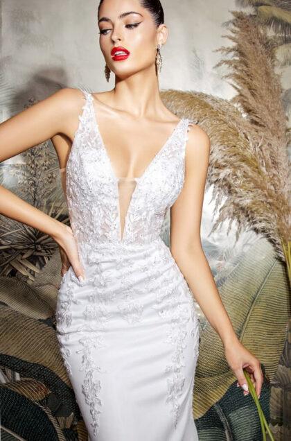 Los mejores precios de vestidos de novia con corte sileta de sirena, escote en V profundo, sin mangas, apliques de encaje y botones de tela - Bridal Room Boutique - Isla de Margarita y Caracas